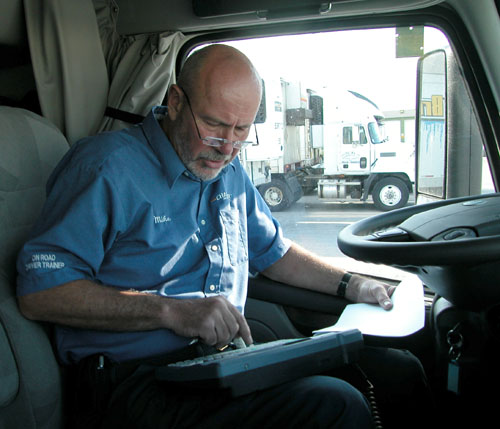Mike Watts catches up on paperwork while we wait for the LCBO to unload 22 tons of Corona beer