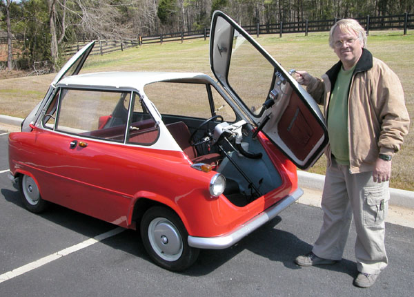 The Janus has an Isetta-style door on both the front and back, with the rear passengers facing backward