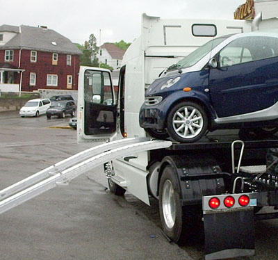 Loading the smart at the dealer. This is the first time the ramps and platform were tried.